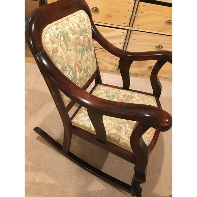 This rocker has been in the family for as long as i can remember but I have no idea how long it has been been in the...