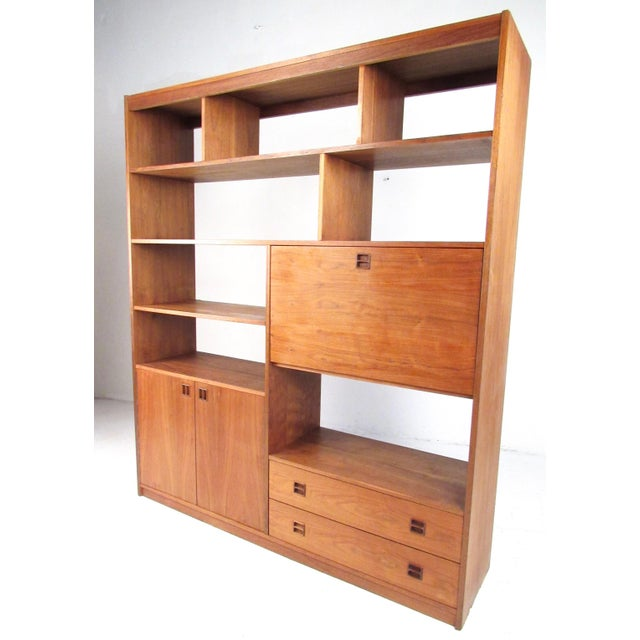 This beautiful midcentury wall unit features rich walnut finish and offers spacious storage options as well as a finished...