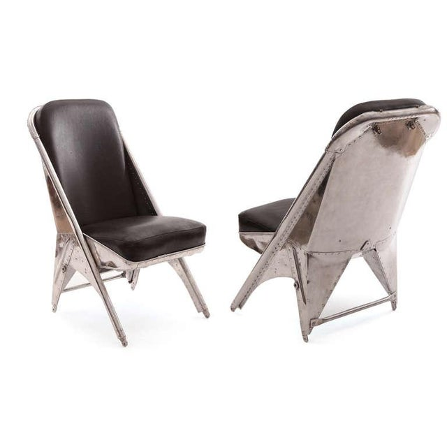 Rare riveted aluminum and leather chairs from a 1940s Cessna airplane. These phenomenal examples have recently been mirror...