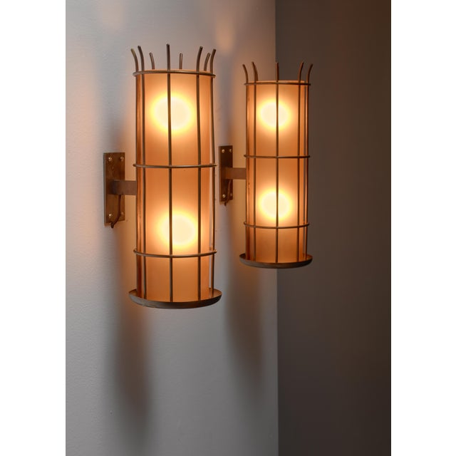 Distinguished Pair of Art Deco brass and orange glass wall lamps ...