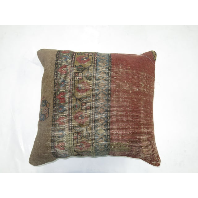 Pillow made from a 19th-century antique persian bakshaish with cotton back. Zipper closure and foam insert provided.