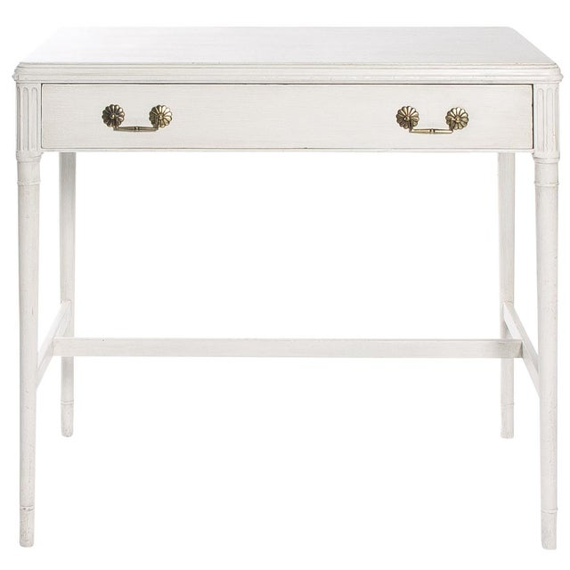 1940s writing desk/vanity by Widdicomb. Recently repainted in an antique white finish with brass drawer pulls. Single...