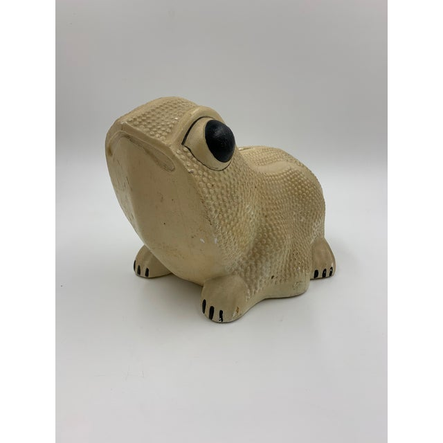 A mid-century Chalkware Frog Bank styled after a Jean Roger design dated 1969, made by A.M. Brooks Corp. Chicago,...