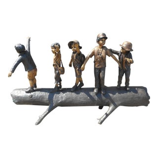 Bronze Statue of Children on a Log For Sale
