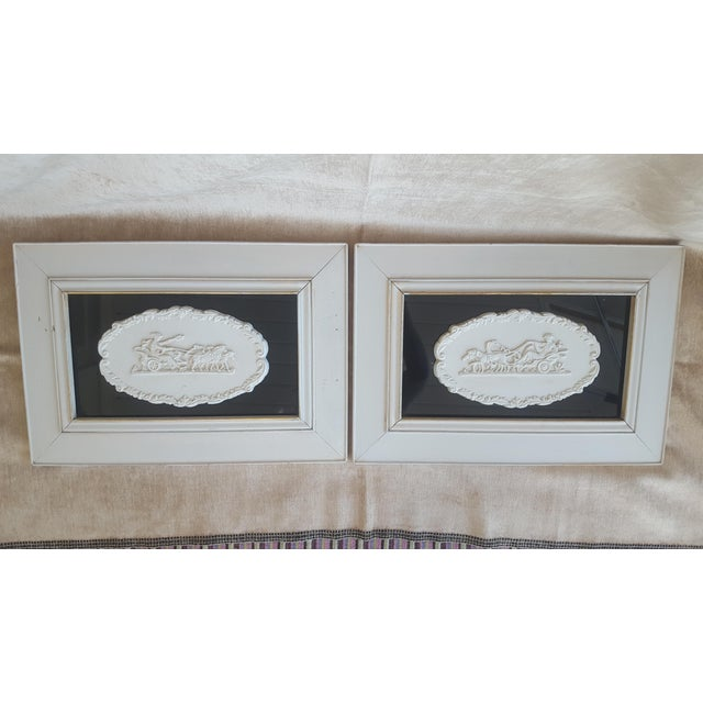 Pair of Large Plaster Intaglios/Cameos attached to a black glass backdrop, and framed in a pale gray wash wooden frame...