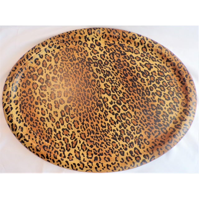 This is a very fun vintage 1980's Leopard design oval tray. The tray is covered in a leopard brown, black and golden...