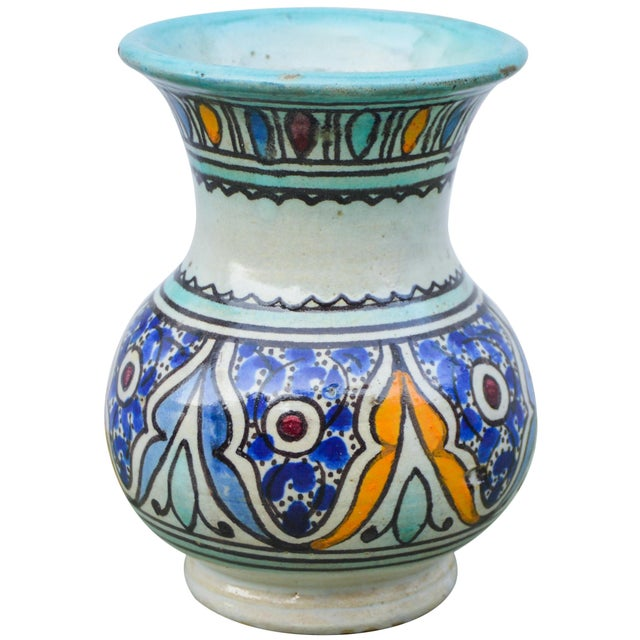 Antique handcrafted Moroccan polychrome ceramic vase featuring an elaborate hand-painted Moorish pattern. Signed and...