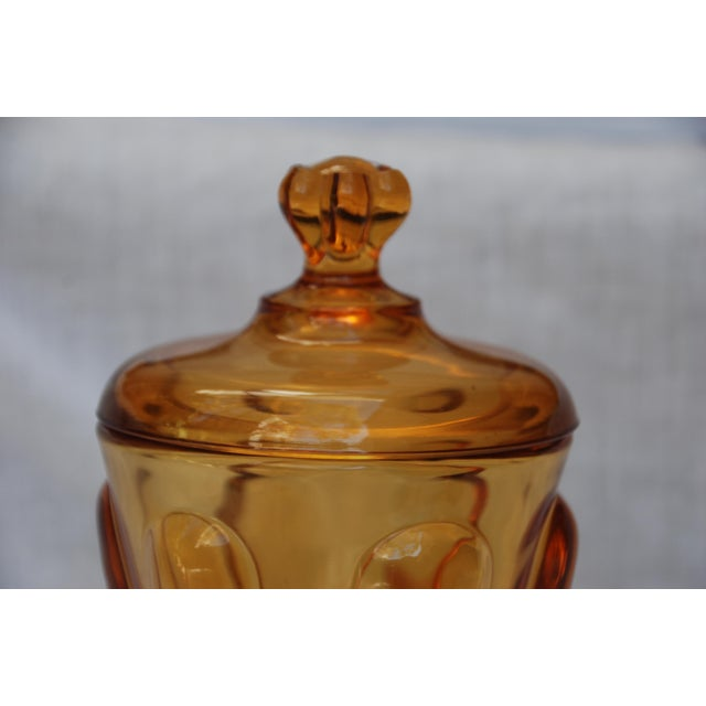 Gorgeous vintage depression glass lidded jar. In an amber color with loads of details in the glass. One micro chip at the...