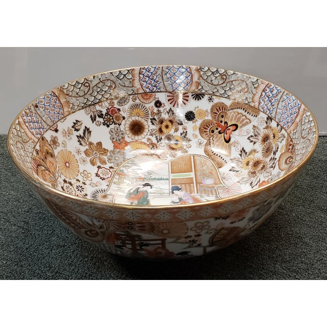 Up for sale is a Vintage Circa 1970 Satsuma Style Porcelain Figural, Floral, and Butterfly Motifs Punch Bowl Made in...