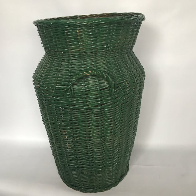 Vintage large urn shape wicker basket with handles and painted green finish. Minor breakage as photographed.