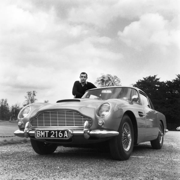 Sean Connery was the first James Bond (and perhaps the best). Our beloved 007 is pictured here with his Aston Martin DB-5....
