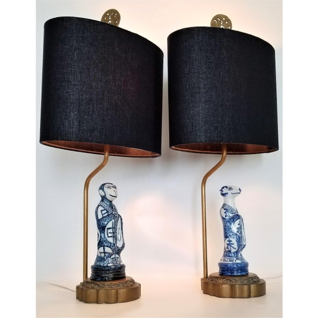 Offering a very unique pair of vintage Chinese Zodiac figurine lamps. These lamps are smaller scale and are perfect for a...
