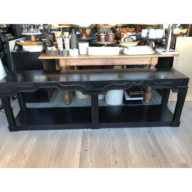 This vintage sofa table has been refinished in an ebony stain. Beautiful curved detail reminiscent of moroccan style.