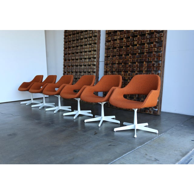Six swivel armchair by Arthur Umanoff for Madison Furniture. Upholstered in Maharam tonica rust fabric.