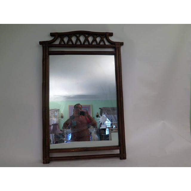 This faux bamboo wooden mirror takes it's design from the far east, but it is an American product. It is large and could...