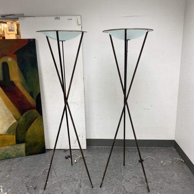 Design Plus Gallery presents a Pair of Tripod Floor Lamps. Originally purchased from the San Francisco Design Center in...