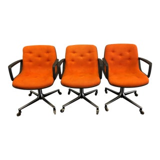 Vintage Mid Century Modern Orange Swivel Office Chairs in the Style of Charles Pollock - a - Set of 3 For Sale