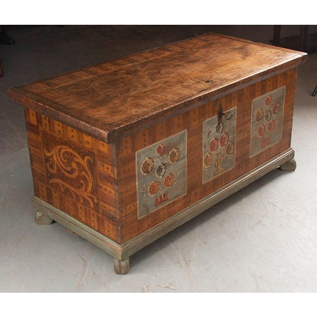 A delightful painted trunk, from the Alsace region of France, created at the middle of the 19th century. The antique trunk...