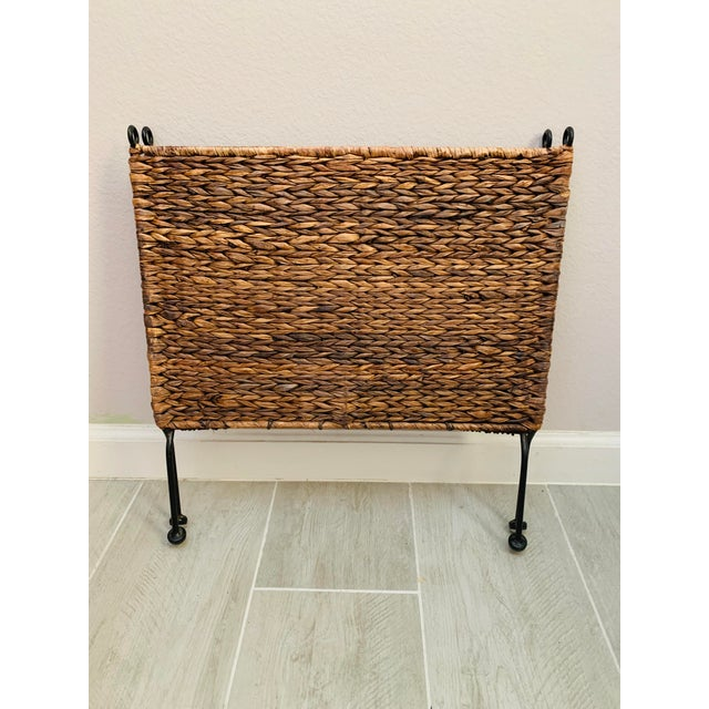 A folding vintage wicker magazine rack with black metal frame. A great storage piece that could organize your papers,...