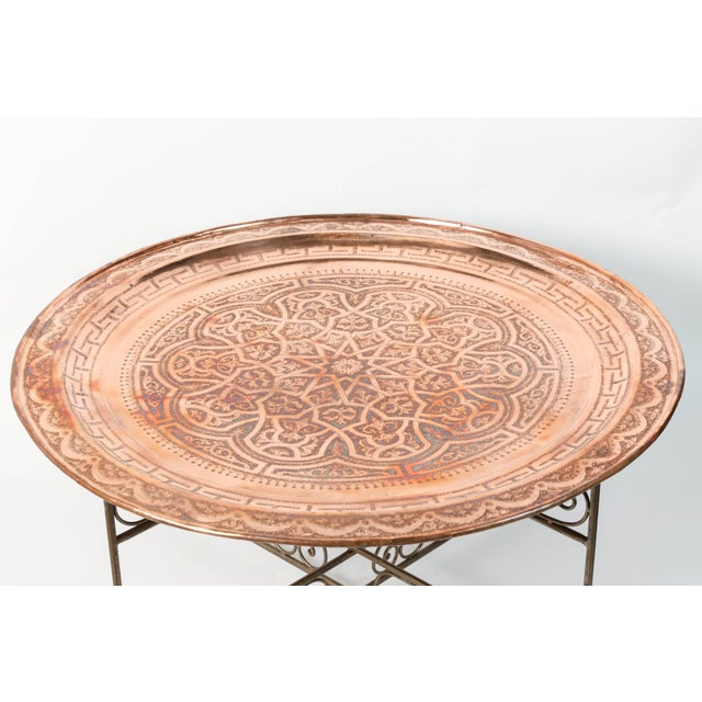 Moroccan large round copper tray table on iron folding base. Nice handcrafted polished brass metal tray, hand-hammered...