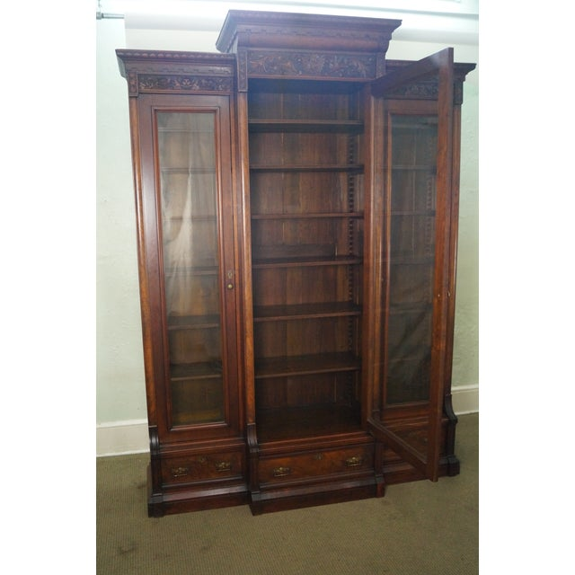 An antique Victorian walnut, tall 3 door bookcase. AGE/COUNTRY OF ORIGIN: Approx. 150 years, America. DETAILS/DESCRIPTION:...