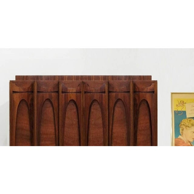 Mid Century Modern Paul Evans Brutalist Style Sculpted Walnut Gentleman's Chest / Armoire Armoire is in excellent...