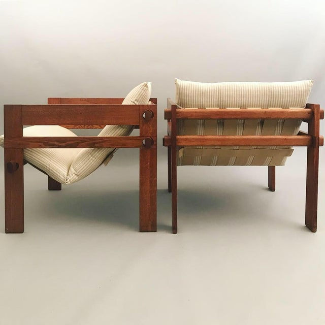 Pair of Lounge chairs with solid oak frame and locking joints.. Canvas Upholstery. Designed by Tage Poulsen for Danish...