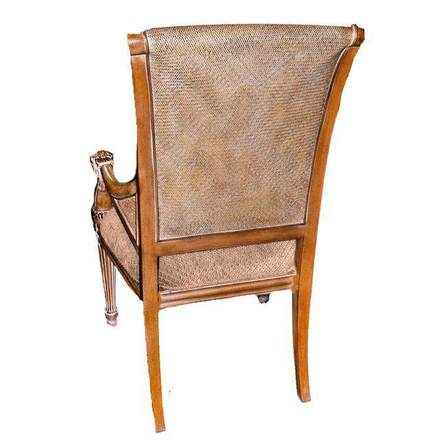 A pair of Louis XVI style fauteuils. This pair of Thomasville side chairs feature an antiqued walnut finish and have...