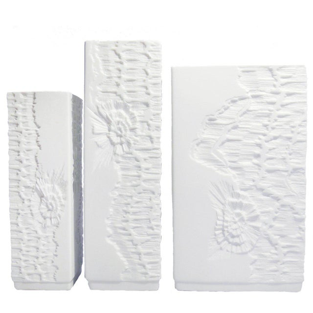 Set of three white bisque porcelain vases designed by Martin Freyer for Kaiser featuring an unique fossil bas relief...