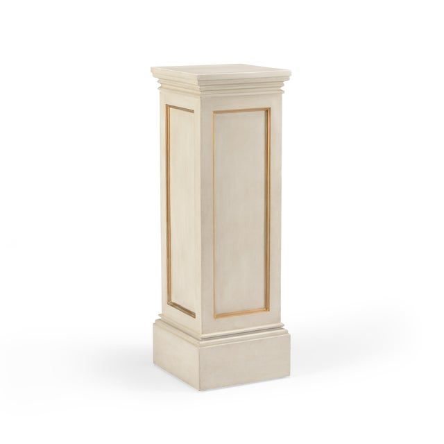 This is a gilt pedestal by Chelsea House Inc. The piece is rendered in hand-finished wood.