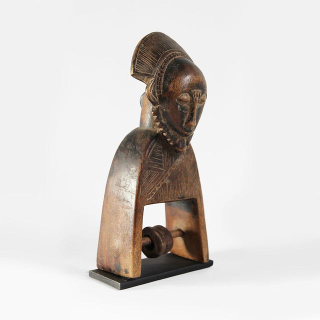 Vintage authentic heddle pulley from the Guro people of the Ivory Coast. These unique wood carved artifacts were used as...