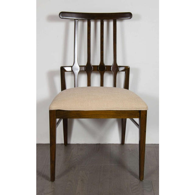Mid-Century Modernist dining chair by Danish designer Niels Koefoed in a chic hand-rubbed Rosewood. This piece exemplifies...