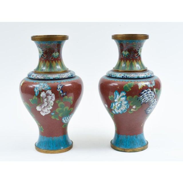 Antique pair of cloisonné decorative pieces / vases with Flowers designs details. Each vase / piece is in excellent...