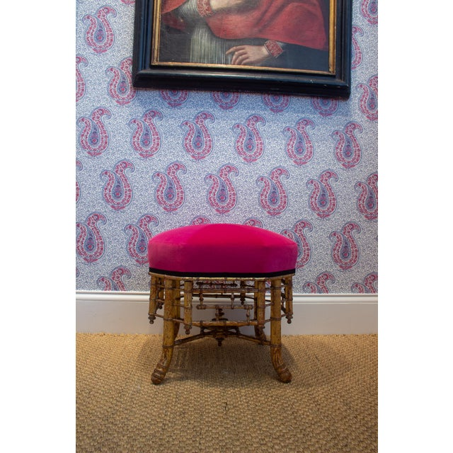 Pentagonal Shape. Giltwod base with a newly upholstered top in a rouge velvet fabric with a black ribbon trim France, Ca....