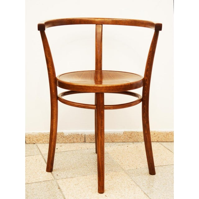 This armchair was first shown in the Thonet catalog in 1904 (catalog number 8 or 6008). It has been restored with a...