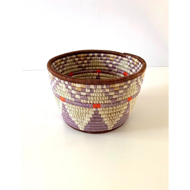 A beautiful, handwoven planter basket from Rwanda, made with all natural sisal and sweetgrass. Use as a stylish storage...