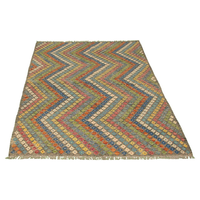 Type of rug: Kilim Country of origin: Turkey Construction: Flatweave Material: Wool Handmade items are typically perfectly...