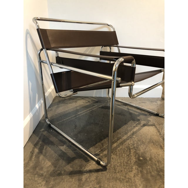 Fabulous chair in the style of classic Wassily chair. Stainless Steel frame with Brown leather straps.