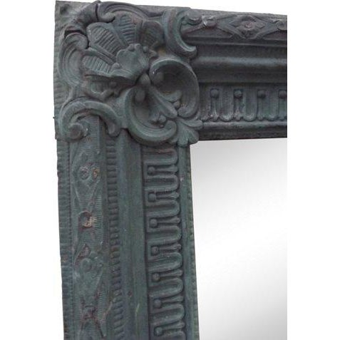 Copper repoussé mirror with verdigris finish dating from the middle of the 19th century. Retains its original looking...