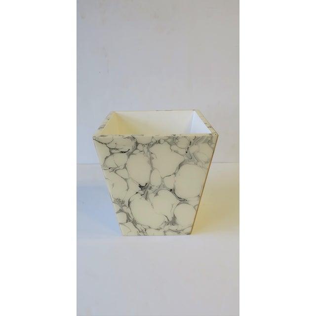 A beautiful black and white marbleized wastebasket [waste basket] or trash can set. Wastebasket set has an acrylic marble-...
