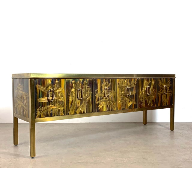 Exquisite credenza designed by Berhnard Rohne for Mastercraft c1970's. Signature Rohne acid etched panelwork, framed in...