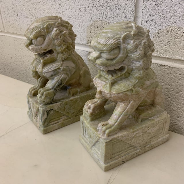 Very unusual heavily variegated stone or marble carved foo dog bookends. Gorgeous and unique color. Almost pink and green....