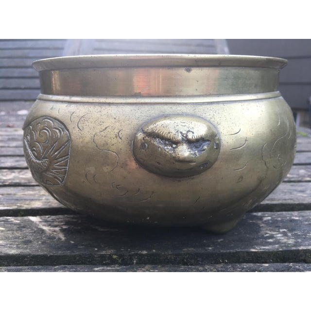 Vintage Brass Pot has hand etched dragons on each side and features unusual dragon heads with faces as handles as well as...
