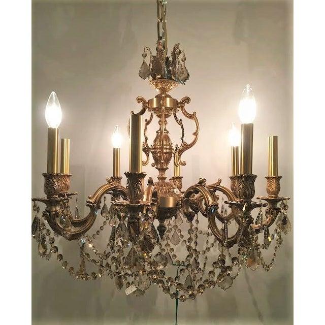 A French brass chandelier with custom Swarovski Strass crystals.