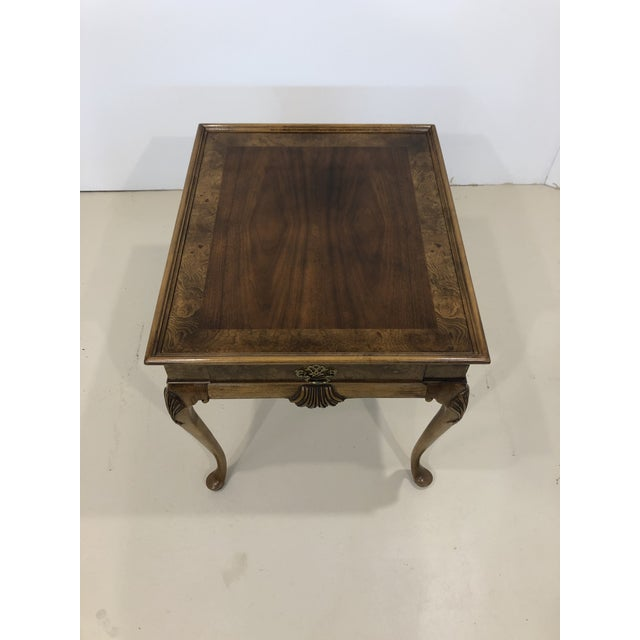 Baker Furniture mahogany and burl wood side table. Has single drawer storage. Beautiful carved Queen Ann legs. Mahogany...