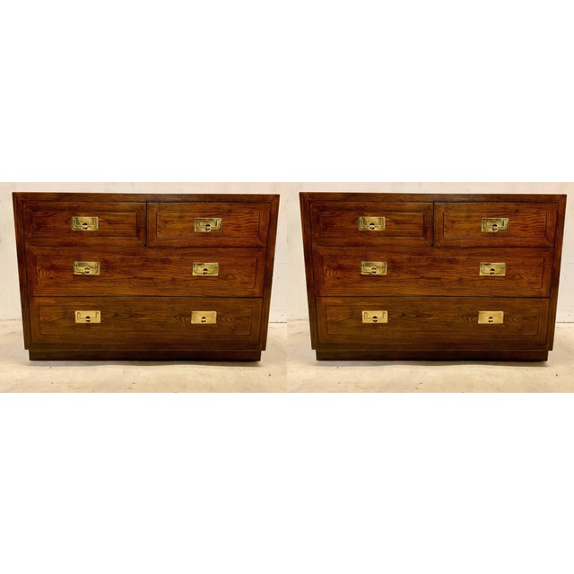 These are a pair of campaign style chests attributed to Henredon. They are unmarked and in very good condition.