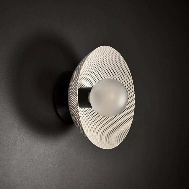 The Petite Centric wall sconce or flushmount is a stately take on French modernism, featuring a spun metal mesh shade. A...