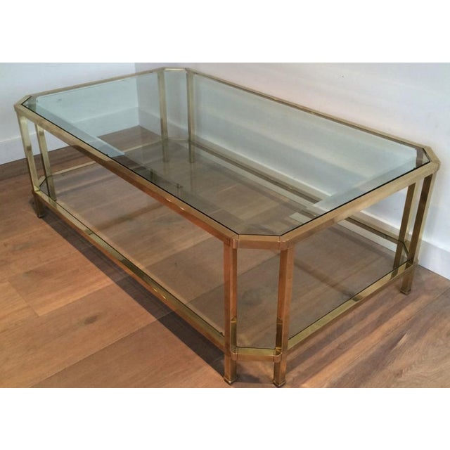 Beautiful Mid Century Modern Roche Bobois Brass Coffee Table With Octagonal Corners. 2 tiers of inset glass shelves with a...