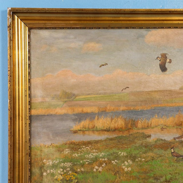 Original Antique landscape painting of shore birds in flight over a marsh, with a bucolic pasture and farm on the horizon....