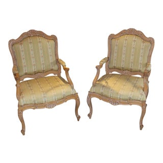 A Pair of French Bergere Arm Chairs For Sale